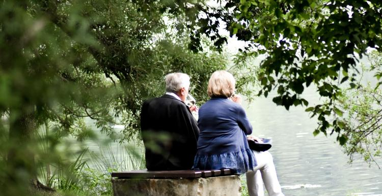 A couple sitting on a stone