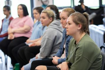 Young people listening in a group