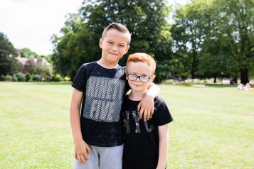 Two young boys on the grass