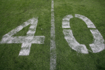 White number four and zero painted on grass
