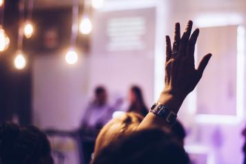 Raised hand at an event