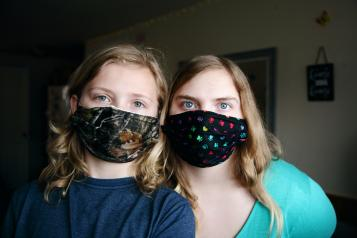 Two young people wearing face masks