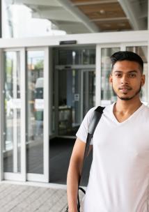 Youn South Asian man standing